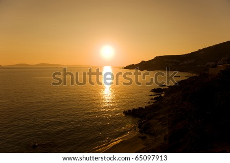 Sunset over port of Mykonos, Greece - stock photo