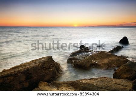 Sunset over Port Philip Bay, Melbourne, Australia.  View from Half Moon Bay, near Black Rock. - stock photo