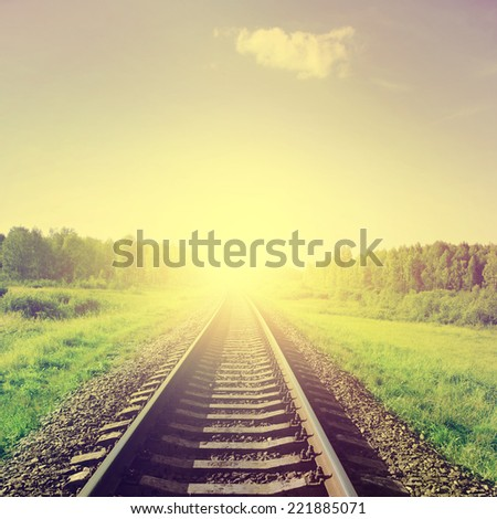 Sunset over railroad in vintage style.  - stock photo