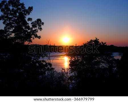 Sunset over Rice Lake in the Kettle Moraine State Forest of Wisconsin - stock photo