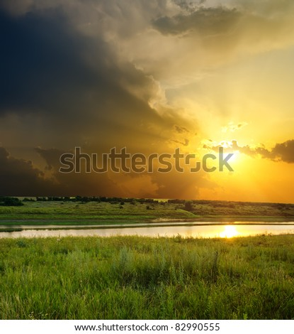 sunset over river - stock photo