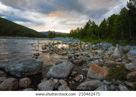 Sunset over river and fjord, Norway. - stock photo