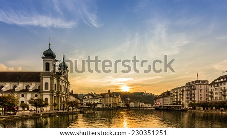 Sunset over river Reuss in Lucerne, Switzerland. - stock photo
