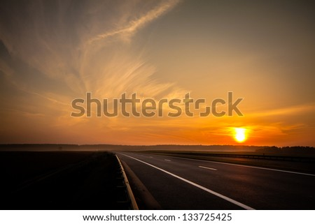 sunset over road - stock photo