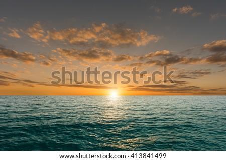 Sunset over sea - stock photo