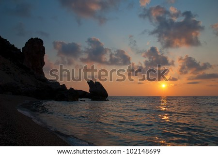 Sunset over sea and rocks