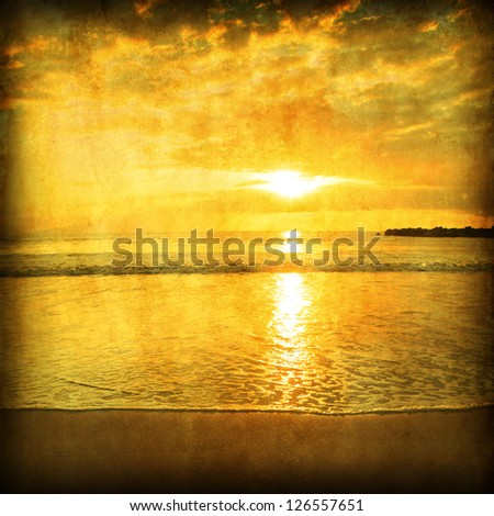 Sunset over sea in grunge and retro style. - stock photo