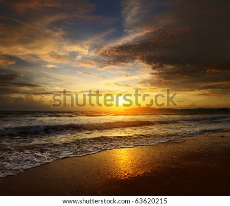 Sunset over sea with clouds - stock photo