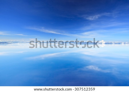 Sunset over sea with reflection - stock photo