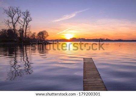 Sunset over Serene Water of Lake Paterwoldsemeer - stock photo
