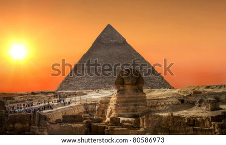 Sunset over Sphinx and Pyramid of Chefren in Giza - stock photo