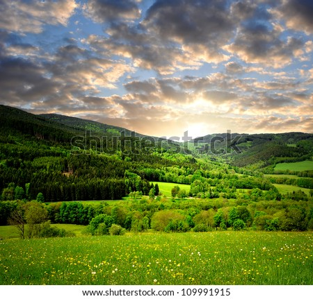 sunset over spring landscape - stock photo