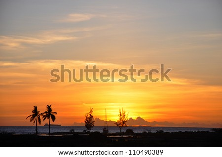 Sunset over St Lucia in the Caribbean - stock photo