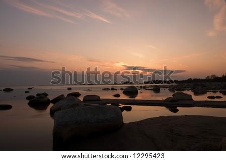 Sunset over swedish beach - stock photo