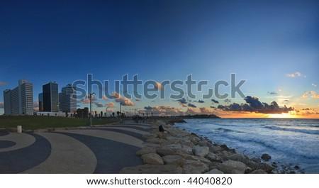 sunset over tel aviv in israel - stock photo