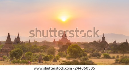 Sunset over temples of Bagan, an ancient city located in the Mandalay Region of Burma, Myanmar, Asia. - stock photo
