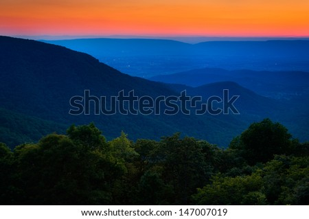 Sunset over the Appalachian Mountains and Shenandoah Valley from Crescent Rock Overlook, on Skyline Drive in Shenandoah National Park, Virginia - stock photo