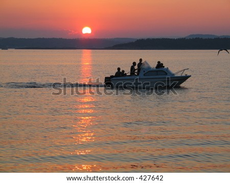 Sunset over the archipelago outside Sandefjord, Norway with a small boat
