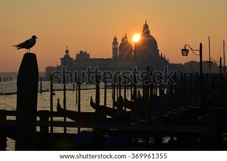 Sunset over the Basilica of Santa Maria della Salute, by the Venice Lagoon, Italy - stock photo