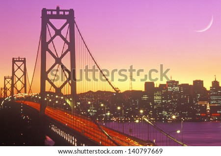 Sunset over the Bay Bridge to San Francisco from Treasure Island, California - stock photo