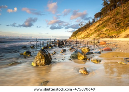 Sunset over the beach, the sea, the cliffs on the island of Wolin,Poland