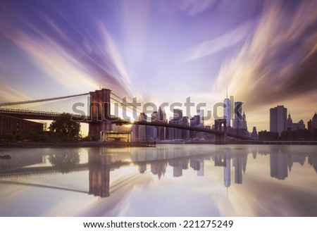 Sunset over the Brooklyn bridge  - stock photo
