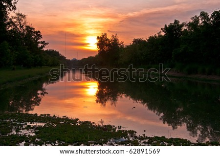 Sunset over the canal. - stock photo