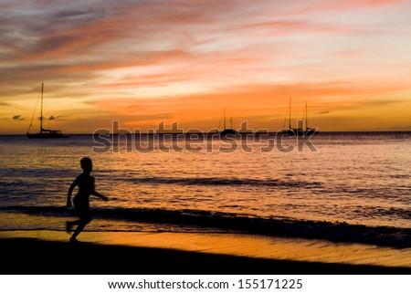 sunset over the Caribbean Sea, Grand Anse Bay, Grenada - stock photo