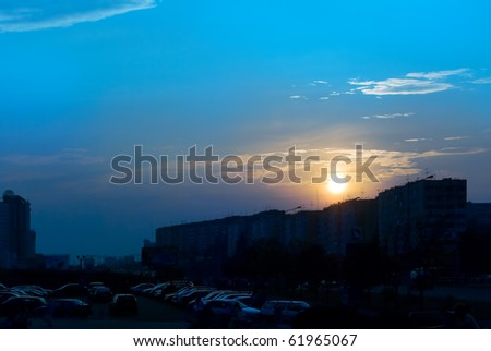 Sunset over the city - stock photo
