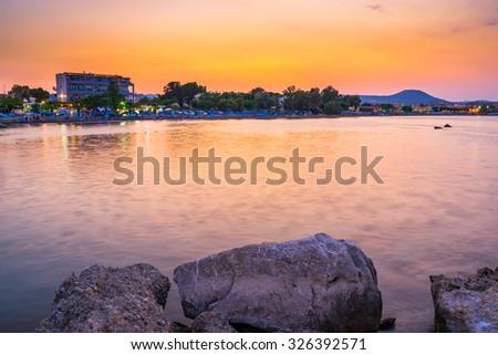 Sunset over the coast of Faliraki  Rhodes, Dodecanese Greece Europe - stock photo