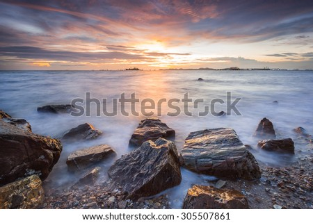 Sunset over The coast of the Gulf of Thailand at Pattaya beach. - stock photo