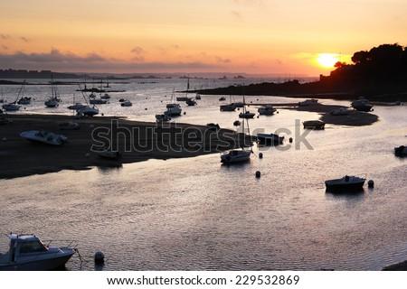 Sunset over the estuary of Fremur river near Saint-Briac-sur-Mer in Brittany, France - stock photo