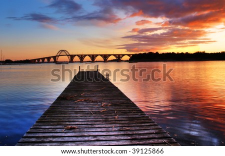 Sunset over the famous landmark Queen Alexandrine Bridge in Denmark.