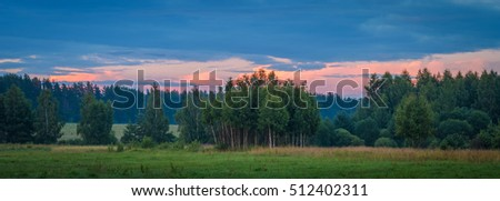 sunset over the fields and forests