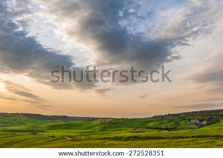 Sunset over the fields in Tuscany, near Pienza, Italy  - stock photo
