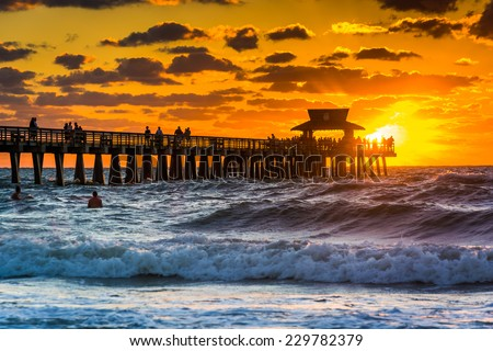 Sunset over the fishing pier and Gulf of Mexico in Naples, Florida. - stock photo