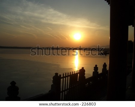 Sunset over the frozen lake at the Summer Palace in Beijing, China. - stock photo