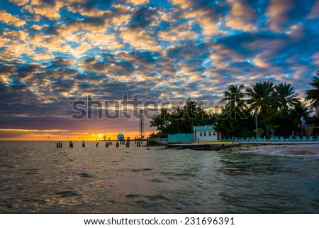 Sunset over the Gulf of Mexico from the Southernmost Point in Key West, Florida. - stock photo
