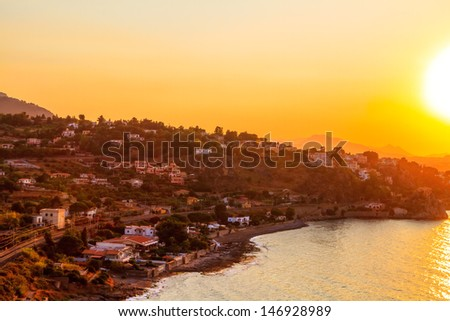 Sunset over the half moon Bay of Sicily - stock photo
