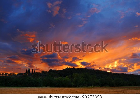 Sunset over the hills - Fantastic sunset over the hills after a storm - stock photo