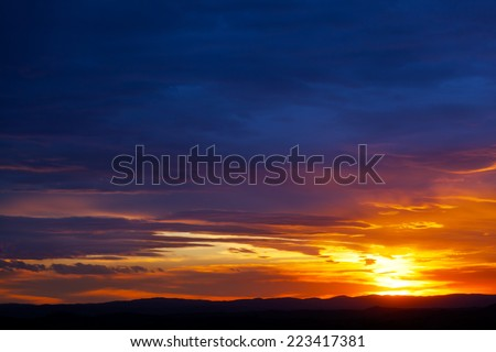Sunset over the hills, Tuscany, Italy - stock photo