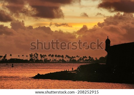 Sunset over the historical fortress surrounding the city of Old San Juan, Puerto Rico - stock photo