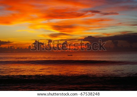 Sunset over the Indian ocean, Dreamland beach, Bali, Indonesia. - stock photo
