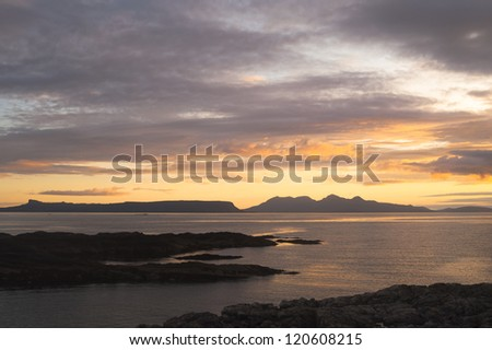 Sunset over the inner hebridean islands of Eigg and Rum. photographed from the Portnaluchaig headland