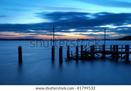 Sunset over the islands of Poole Harbour, Dorset (UK), the second largest natural harbour in the World. - stock photo