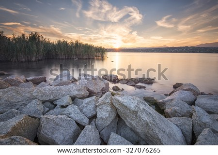 sunset over the lake in the rocks