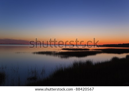 Sunset over the lake on west-coast - stock photo