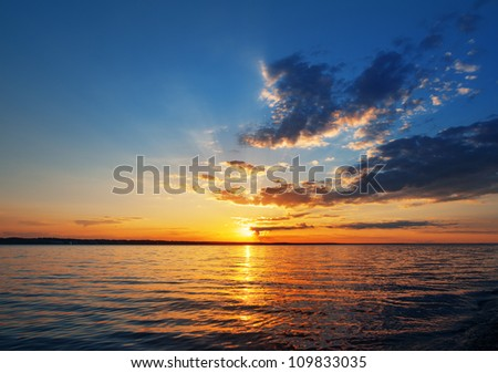sunset over the lake or sea - stock photo