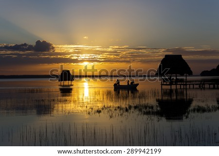 Sunset over the lake peten itza in northern guatemala - stock photo