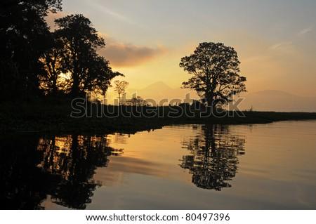 Sunset over the lake Yojoa in Honduras - stock photo